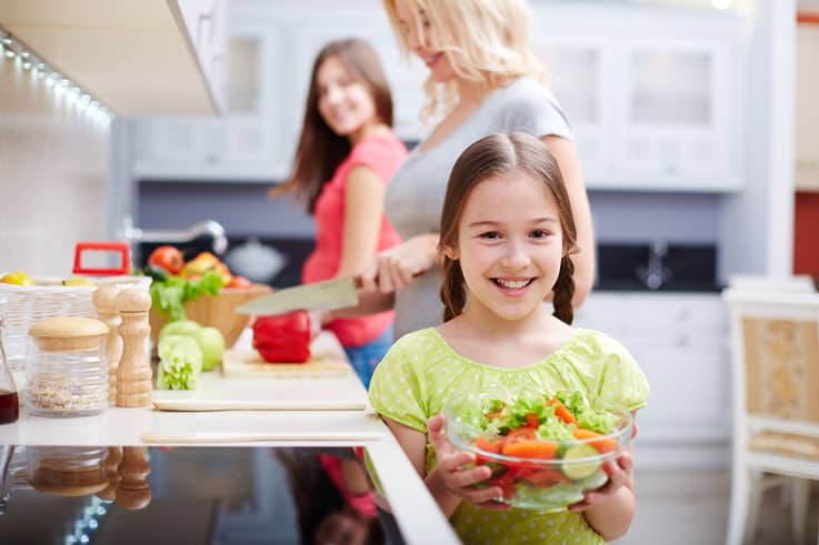 girl preparing salad image