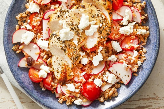 Chicken salad with tomatoes in a bowl