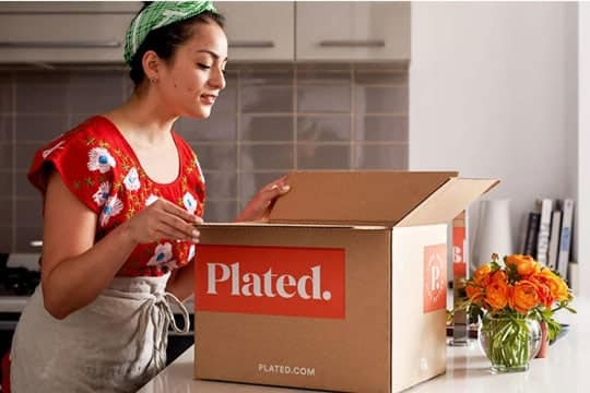 Girl opening a Plated box
