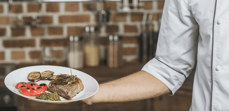 image chef holding delicious steak