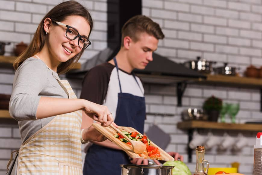 image of cheerful couple cooking