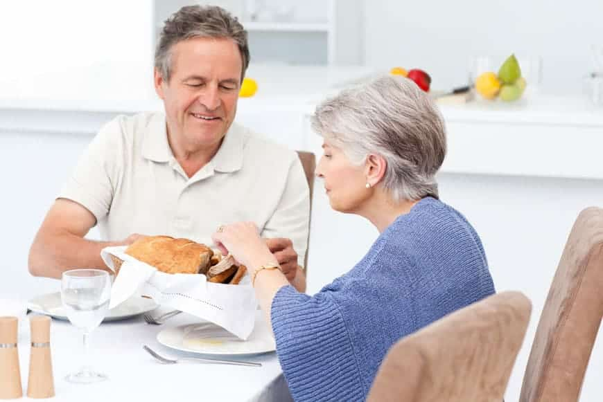 image of elderly couple having breakfast