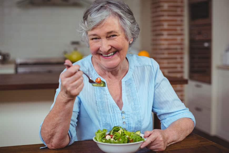 image of old lady eating salad