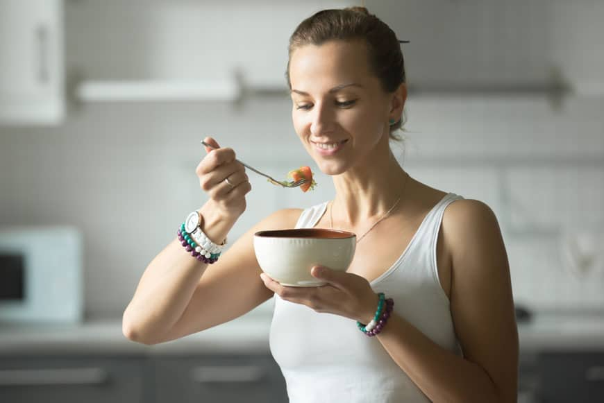 image of woman eating and smiling
