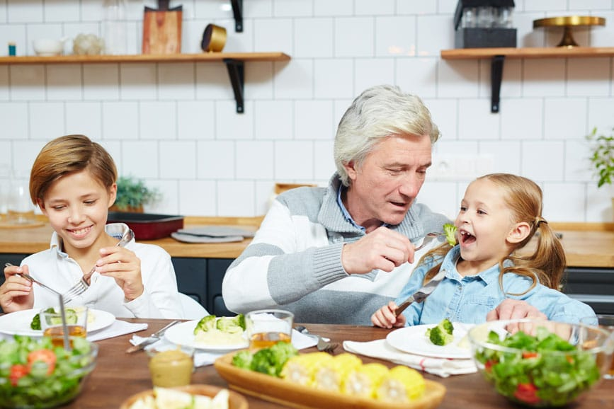 image of grandpa and kids having lunch