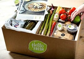 Box of different kinds of vegetables and recipes